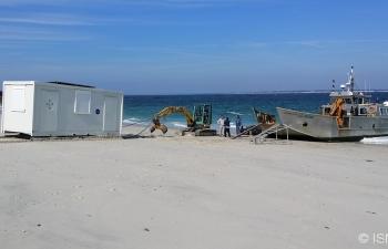 Pose de poste SNSM sur plage